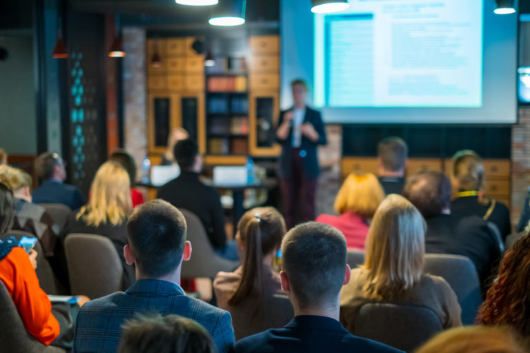 Audience Listens Lecturer At Workshop